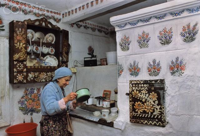 Poland --- Stefania Laczynska in her kitchen, Zalipie, Poland --- Image by © Christophe Boisvieux/Corbis