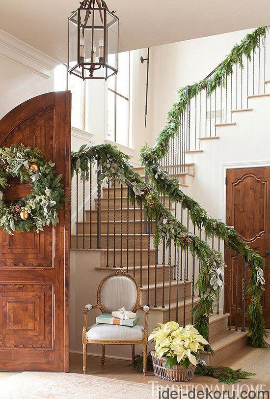 Gorgeous garlands dotted with silver foliage spruce up railings in the entry.