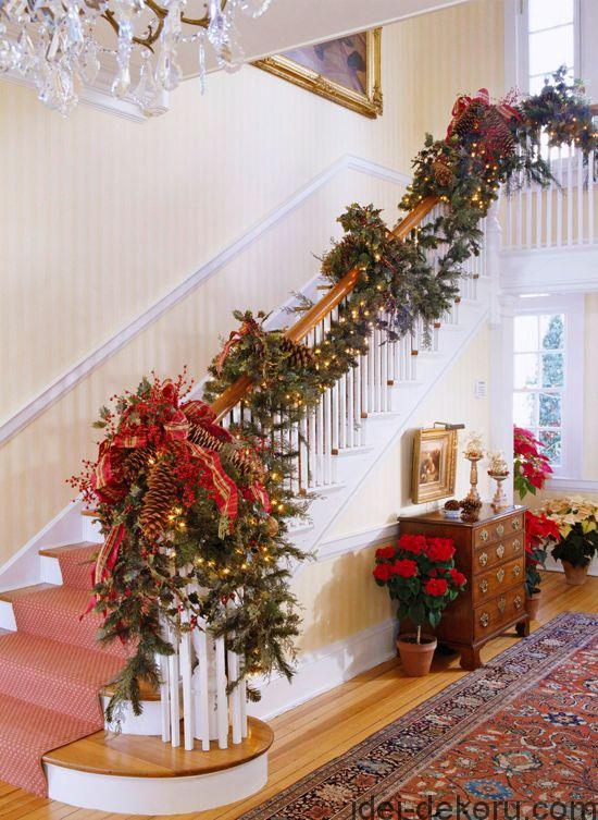 Pinecones add texture to this dramatic Christmas stairwell.