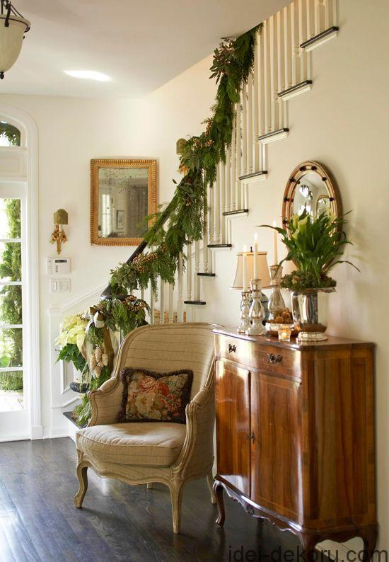 A sunny entryway with simple seasonal décor. Artichokes and a silver bow are fun trimming on a garland of greenery.