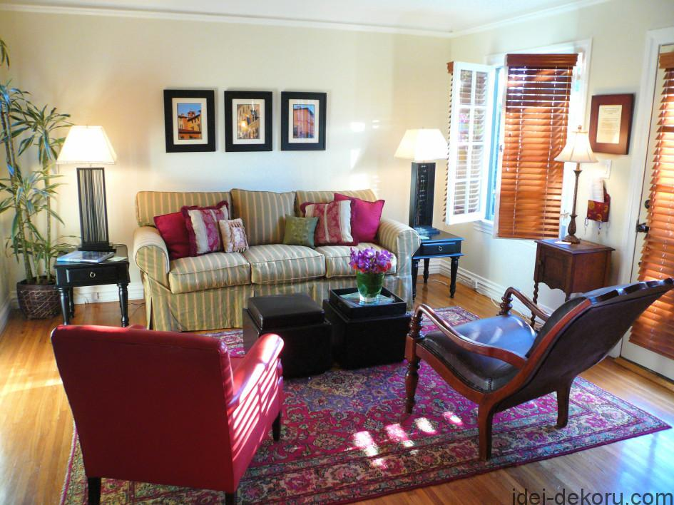 pink-color-ideas-for-living-rooms-accent-chair-and-striped-sofas-with-assorted-seat-cushions-also-black-coffee-tables-over-printed-carpet-945x708