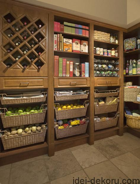 Kitchen pantry in Warm Cognac melamine with Raised Panel drawers, fluted and decorative molding, Cherry Brown rattan baskets and Sliding spice and can racks