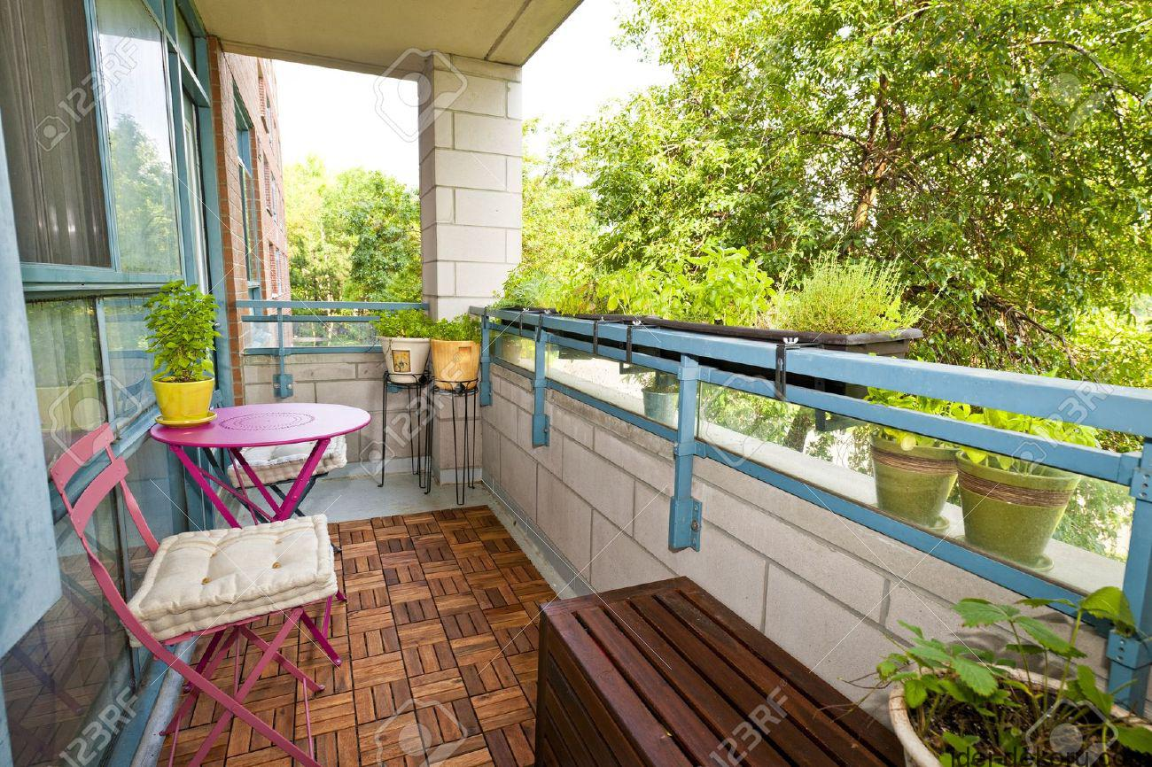 15391764-Balcony-of-condo-with-patio-furniture-and-plants-Stock-Photo-apartment