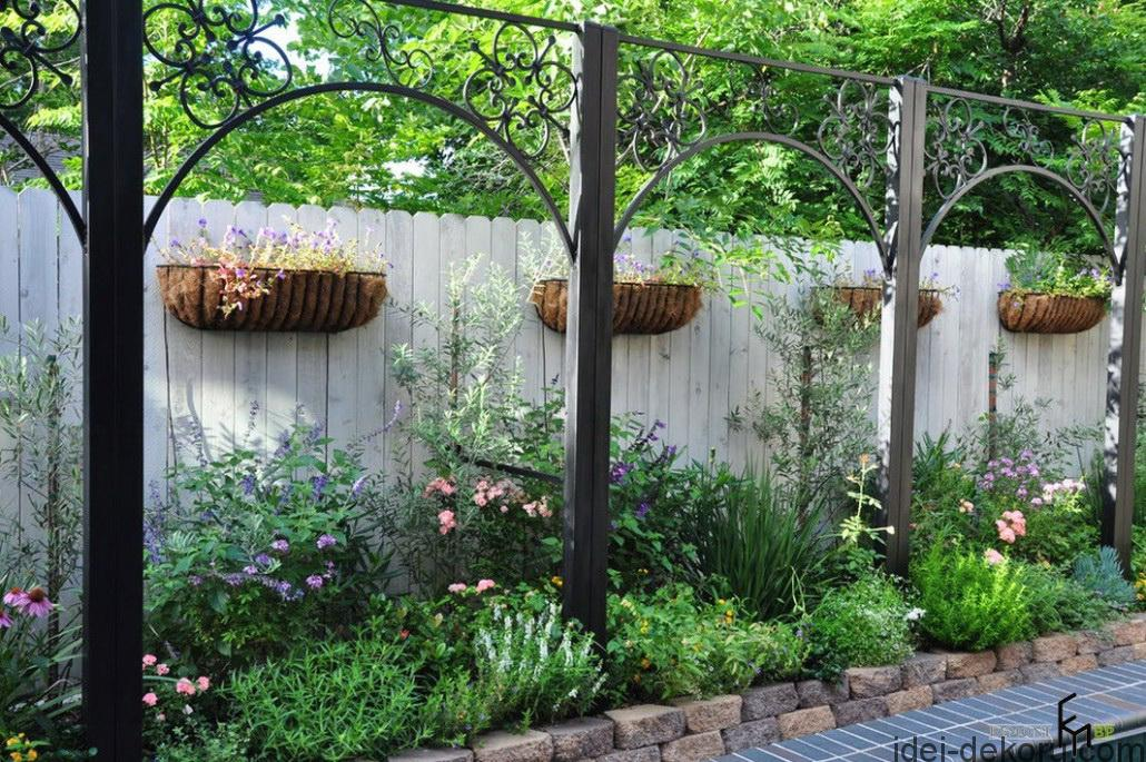 a-classic-white-picket-fencing-with-unique-floating-pot-and-antique-iron-decors-also-colorful-perenial