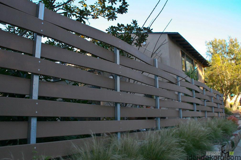 a-strong-wooden-fencing-with-wickery-style-also-small-shrubbery-nearby