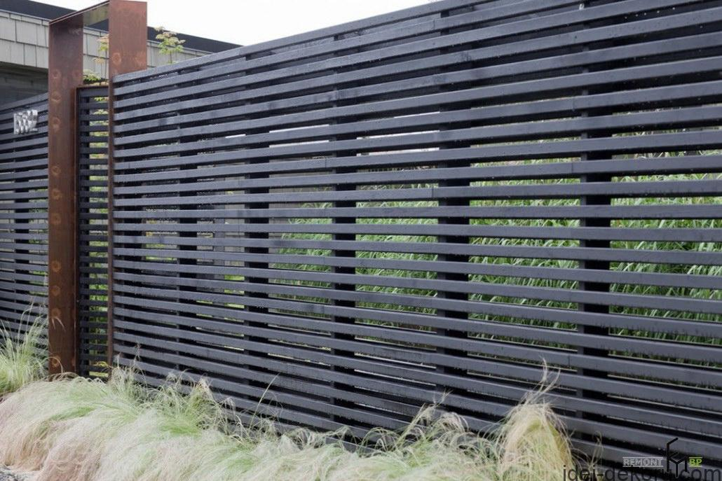 a-stunning-black-iron-fencing-with-shrubbery-for-maximum-backyard-privacy
