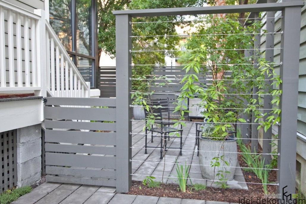an-attractive-grey-wooden-fencing-with-wire-plus-wooden-pathways-for-humbly-backyard-in-classic-white-wooden-house