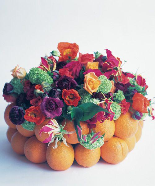 paula-pryke-flower-arrangement-with-oranges