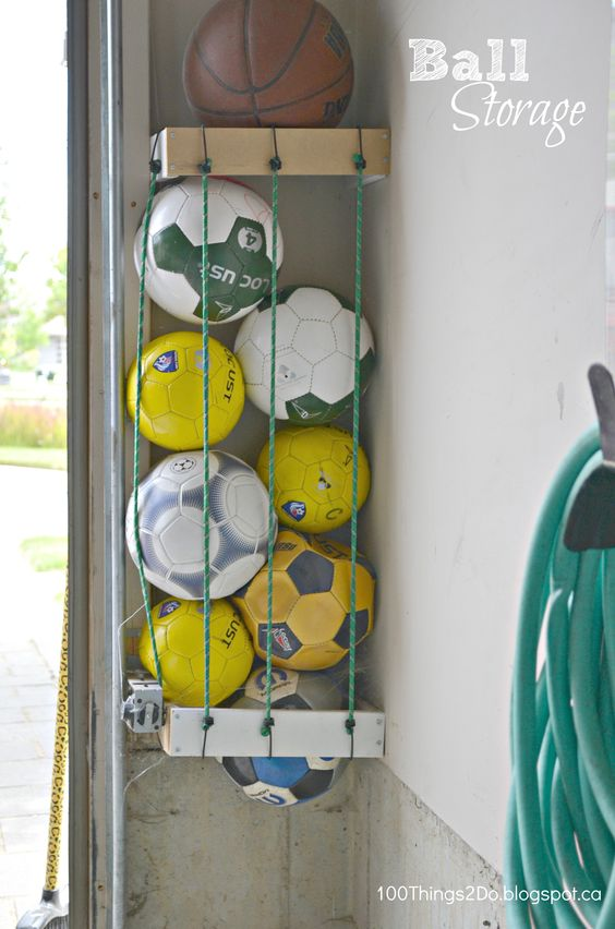 garage10 garage storage organization -- Store sports balls using bungee cords. This genius storage solution allows you to easily access your ball collection, and it's a cinch to put together.