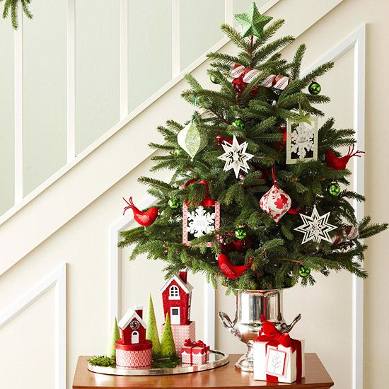 13-small-tree-by-the-stairs-with-tiny-ornaments-bold-red-birds-and-paper-decorations