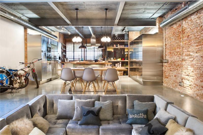 Зона-кухни-и-гостиной-в-пространстве-в-стиле-лофт