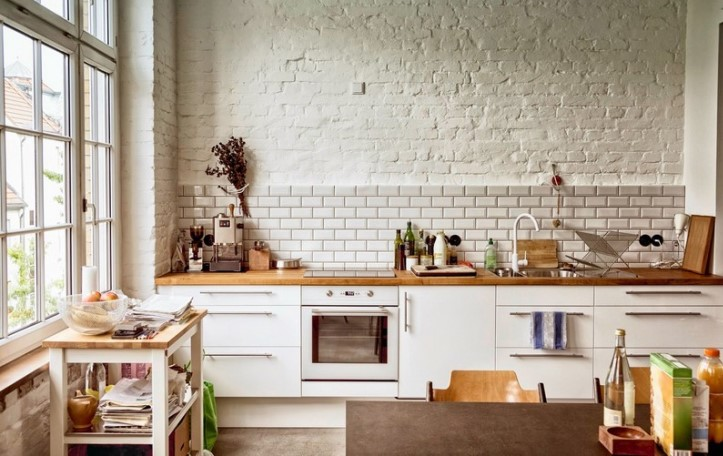 Lived-in European Kitchen lit by a tall side window. Shot at one of the authorized venues during the Berlin Istockalypse 2012.