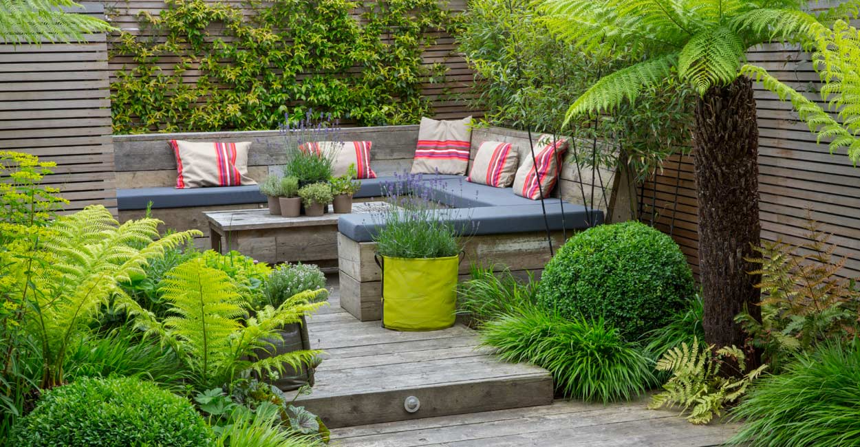 Inspiring-small-garden-design-with-wooden-floor-and-wooden-bench-with-palm-tree