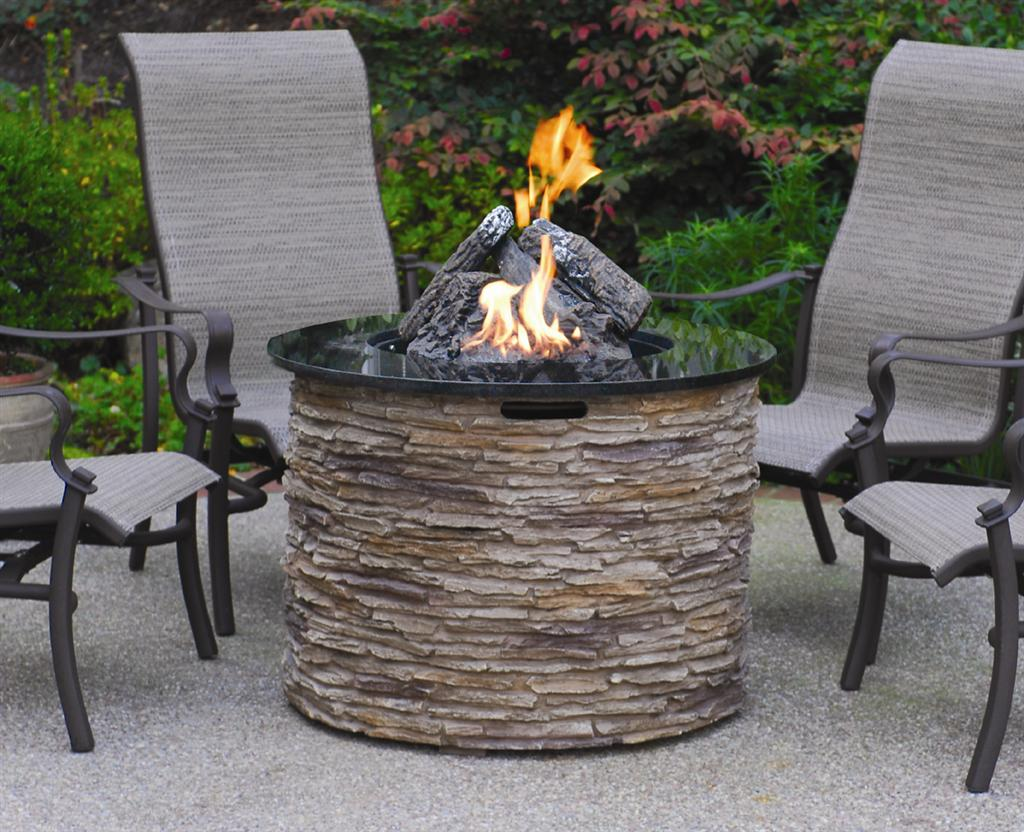 furniture-good-looking-outdoor-living-room-decoration-using-outdoor-black-iron-armchair-including-round-black-granite-top-stone-veneer-outdoor-propane-fire-pit-table-fascinating-furnitur