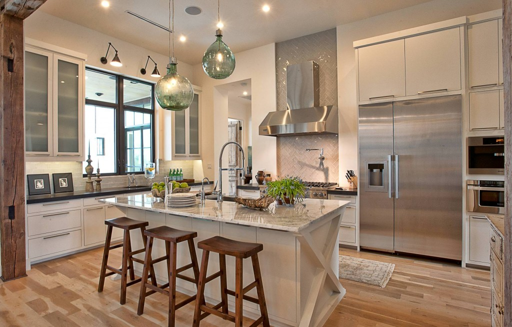 bar-stools-with-marble-countertops-and-kitchen-island-also-kitchen-faucets-with-stove-backsplash-and-kitchen-hood-plus-wood-floors-1024x654