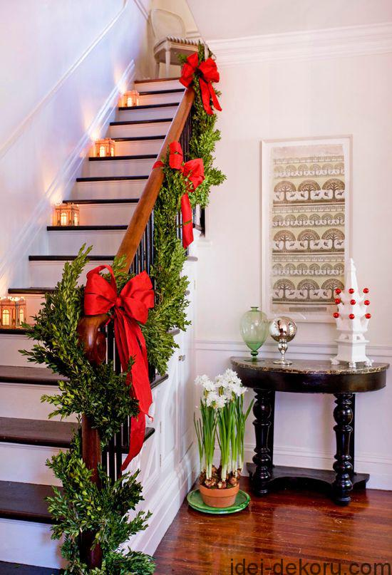 Architectural paper lanterns and lush greens encircling the banister add traditional charm to this staircase.