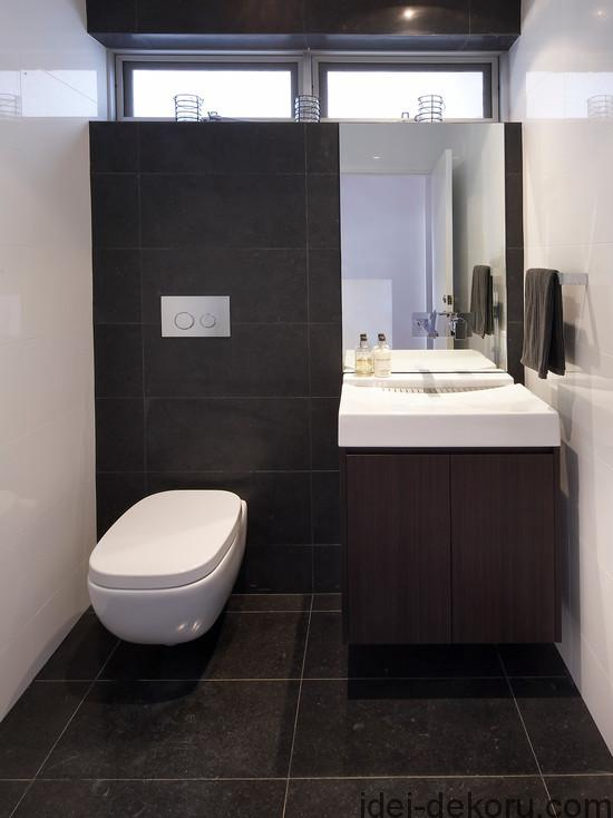 cozy-toilet-design-with-black-color-scheme-fnished-in-modern-design-and-small-bathroom-sink-unit-as-fetching-model