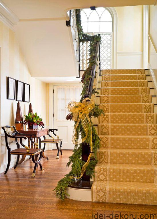 Festive golden ribbons match the sunny stair runner.