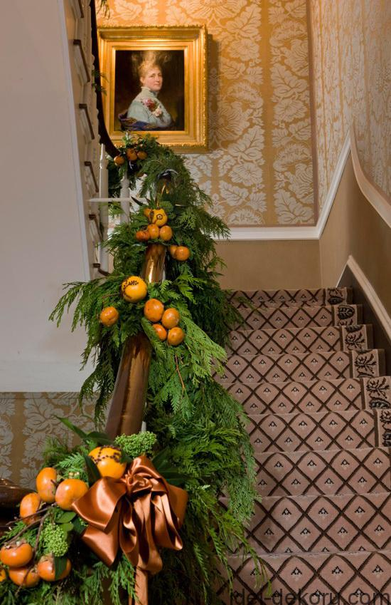 Fragrant pomanders adorn the Blair House staircase during the holidays.