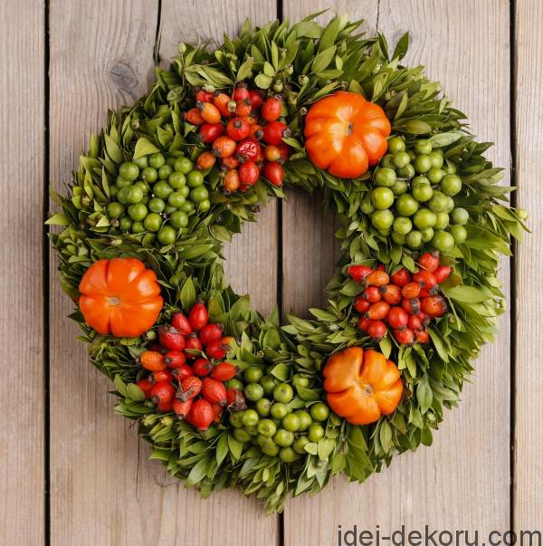 Autumn door wreath on wooden background, copy space
