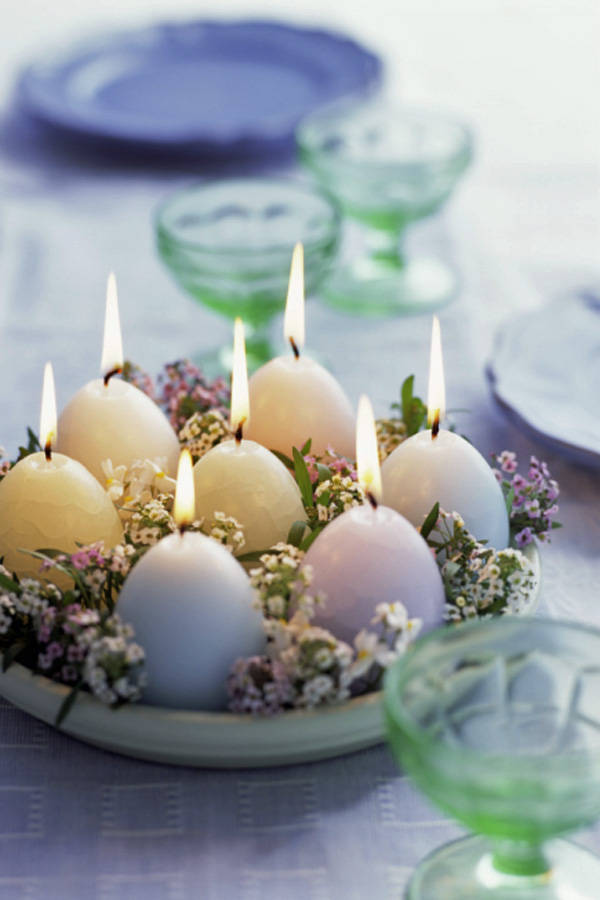 Egg-shaped candles on table