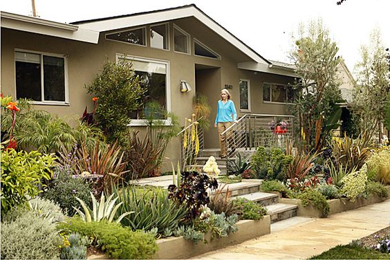 Los Angeles, CA - May 11, 2009: Randy Bergman walks out the front of her home in the Cheviot Hills neighborhood of Los Angeles. Bergman's front yard is very drought tolerant with a colorful assortment of hip unusual-looking succulents. The backyard is meant to include reminders of New York where Bergman lived before and includes a patio shade modeled after NYC street grates.  (Al Seib / Los Angeles Times)